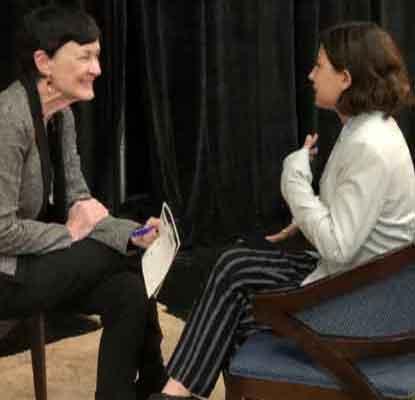 Girl interviewing woman